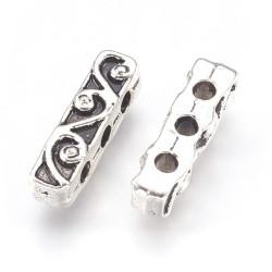 Роздільник на 3 нитки 18мм з завитками двосторонній, сталевий